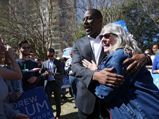 Mayor Andrew Gillum hugs his forme Gainesville High