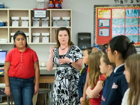 Science teacher Joanna Hughes talks to her fifth-grade
