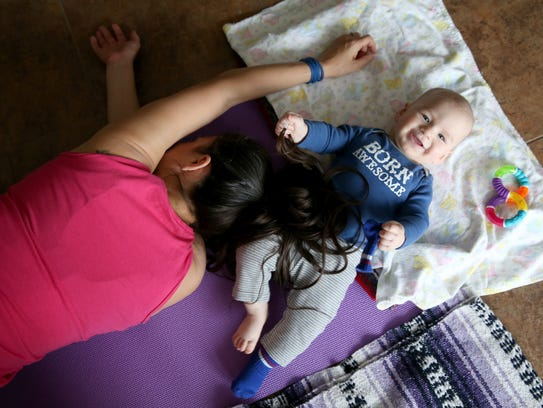 Victoria Freile and Joe during yoga class.