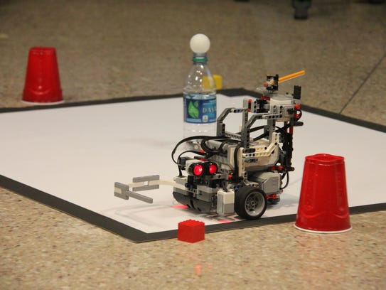 The robots were program to hit the ping-pong ball off