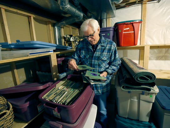 Reminiscing, Don Alhart looks through his record collection