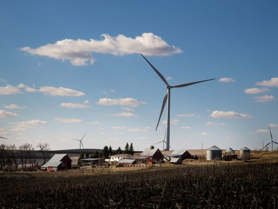 Wind turbines fill the horizon near Ida Grove Thursday,