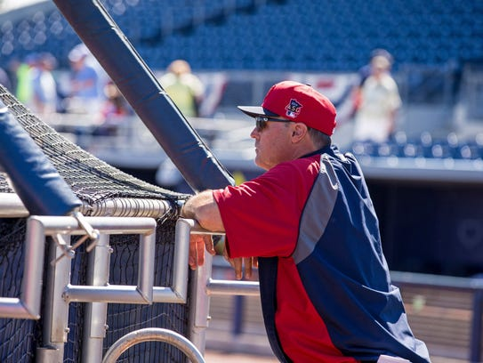 Tom Brunansky watches practice at Target Field. 