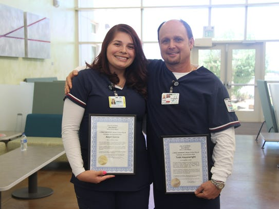 Nursing students Angel Garcia and Todd Houswright received