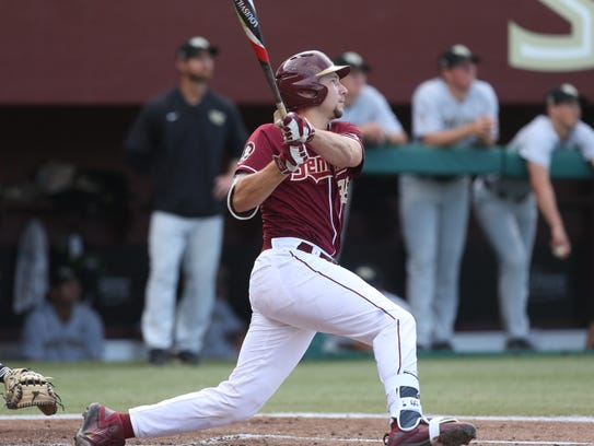 FSU's Cal Raleigh makes contact with a pitch against