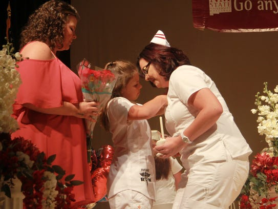 Marlana Berry receives her nurses pin by her daughter,