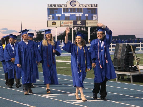 Carlsbad High School graduates walked along the track