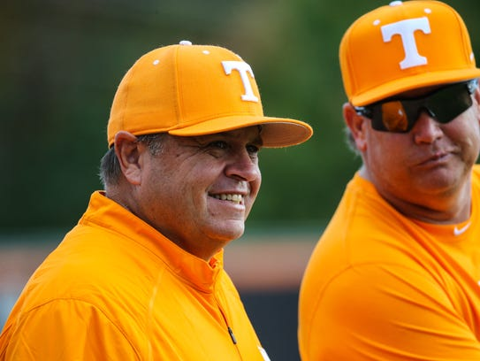 Dave Serrano, left, turns over the Tennessee baseball