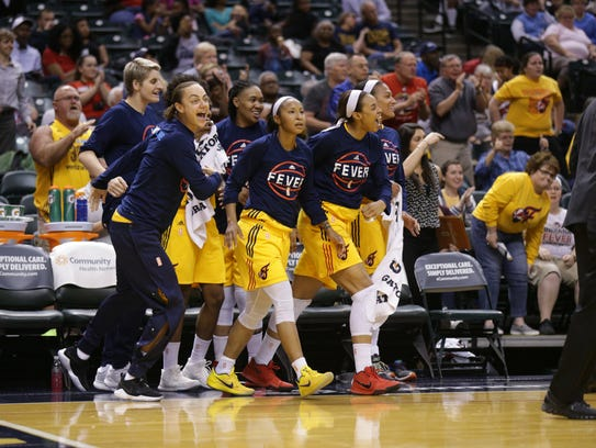Indiana Fever players celebrate a three point shot