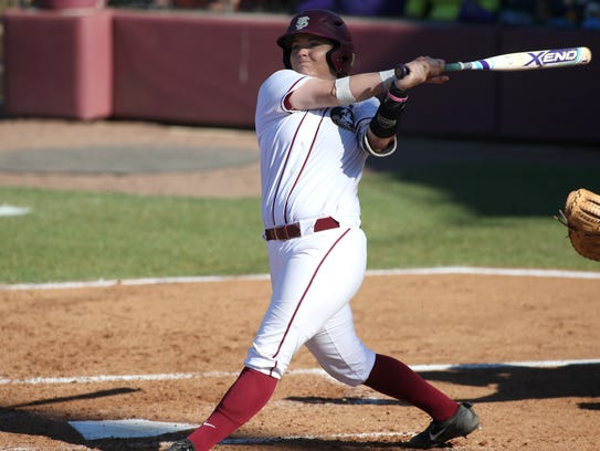 FSU's Jessie Warren makes contact with a pitch against