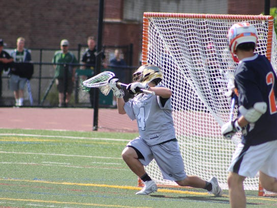 Vestal goalie Luke Barney makes a save during the Golden
