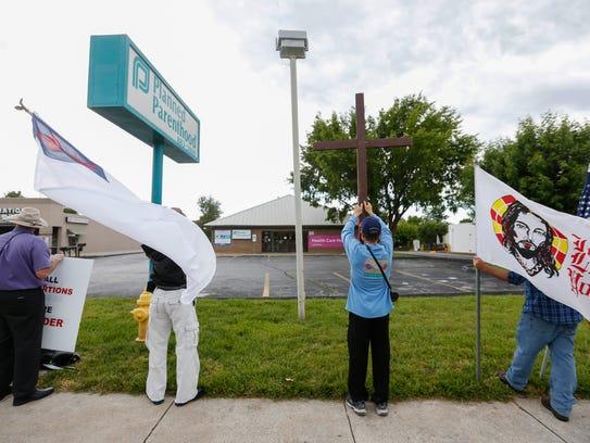 From left, Dennis Vance, Aaron Brummitt, Allen Kemper and Brian Wilson protest in front of Planned Parenthood in 2017.