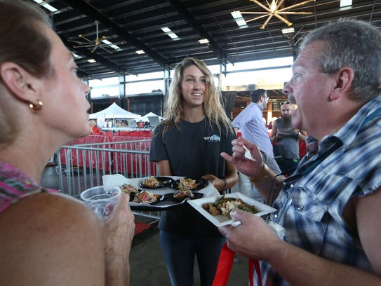 Lexi Fitzpatrick, center, of Wharf Casual Seafood,