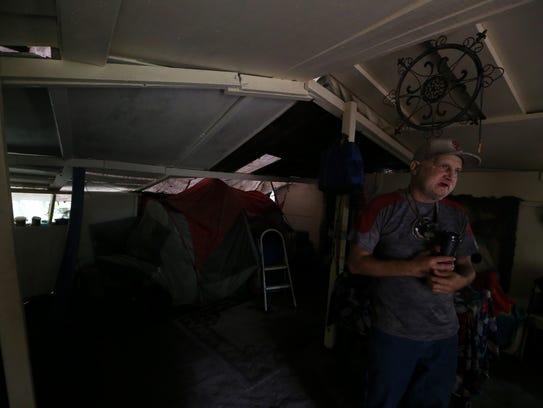 "Dan ""Casper"" Hadders stands inside his makeshift home"