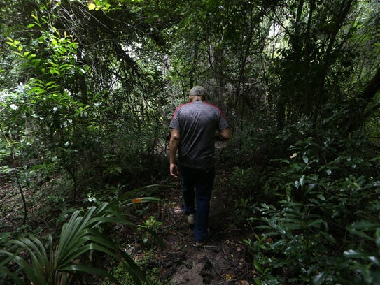 """Dan """"Casper"""" Hadders walks off into the woods, on a"""