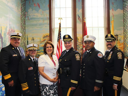 Fire Chief Abraham Pitre (second from left) poses with