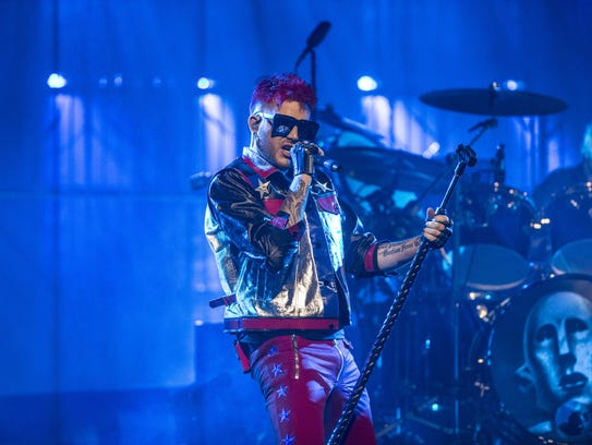 Adam Lambert sings as he performs with Queen during