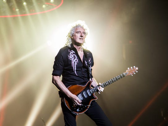Queen guitarist Brian May plays during the Queen +