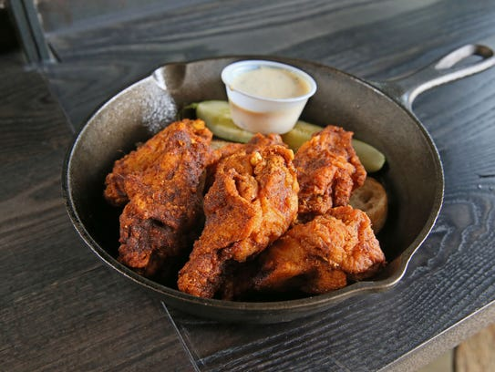 Fuel Cafe makes wings Nashville-style: fried and spicy.
