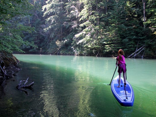 Kelsie Lechleiter, 9, navigates a stand-up paddleboard