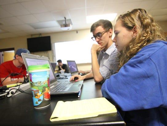 Lauren Gardner learns the finer points of coding for