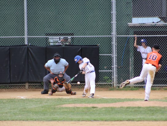Maine-Endwell's Sammy Mancini swings at an offering