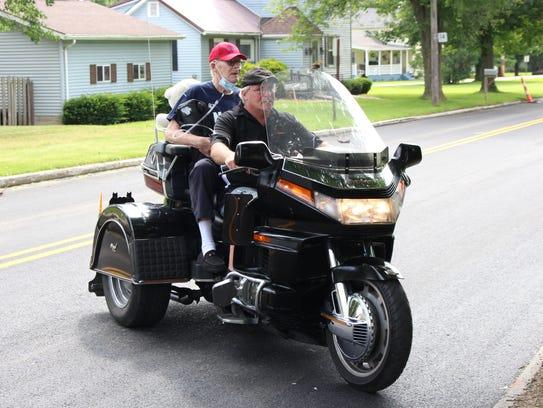 New Washington Navy veteran Mike Jaynes rides a motorcycle