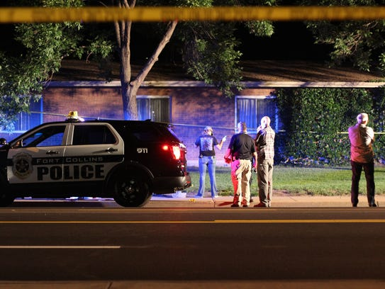 Law enforcement officers investigate the scene of a