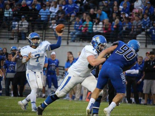 Dakota State QB Jacob Giles fires downfield in last