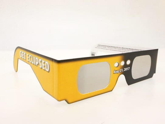 Wear special solar glasses to watch the eclipse.
