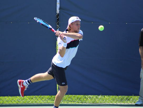 Denis Kudla fires a return shot during the doubles