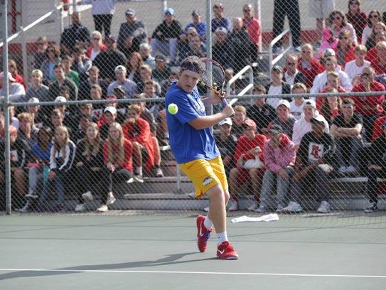 Carmel High School's Patrick Fletchall returns the