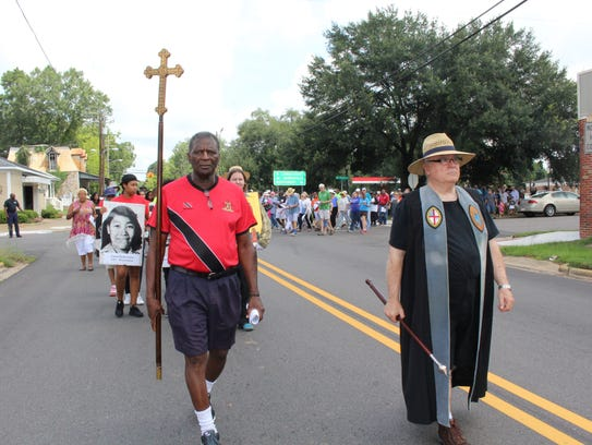 Winston Williams, left, and Don King, lead a march