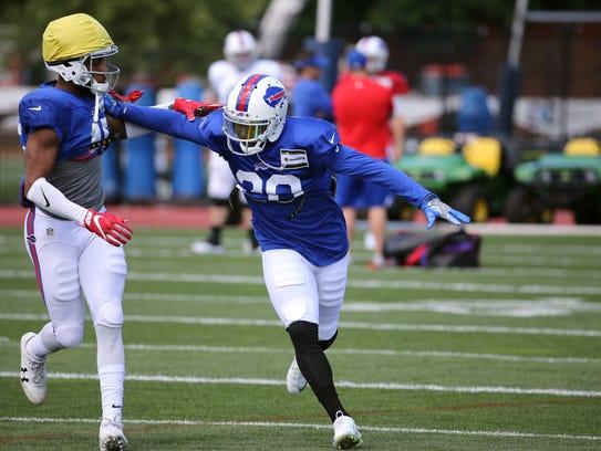 Newly acquired cornerback E.J. Gaines (right) gets