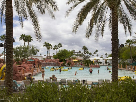 People enjoy the wave pool at the Oasis Water Park