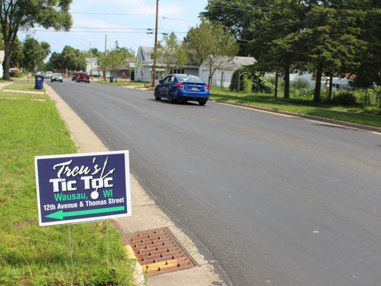 Many signs line the streets parallel to Thomas, showing