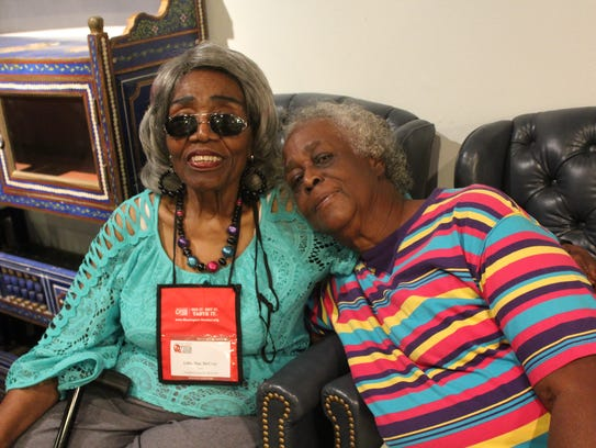 Woodie Ann Vaughns, right, sits with her mother's sister,