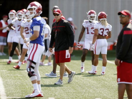 Indiana coach Tom Allen watches football practice Wednesday,
