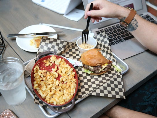 A student enjoys a burger from JStreet Grill, one of