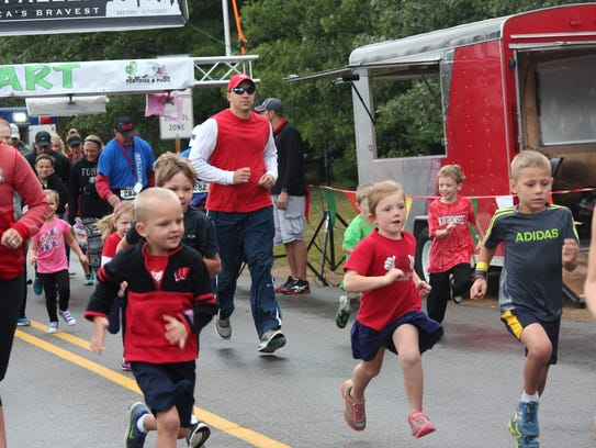 Kids take off in their running event at the Run for