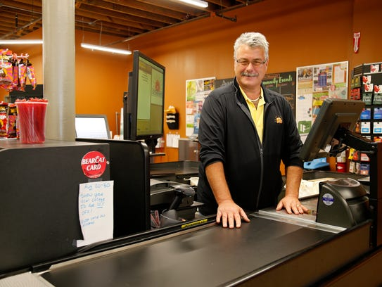 Store manager Keith Brock poses in a checkout lane