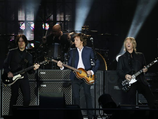 Paul McCartney (C) performs along with US musicians