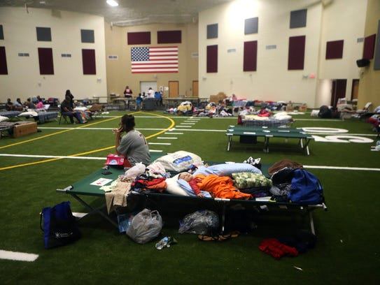 Families take shelter at the FEMA Dome after Hurricane