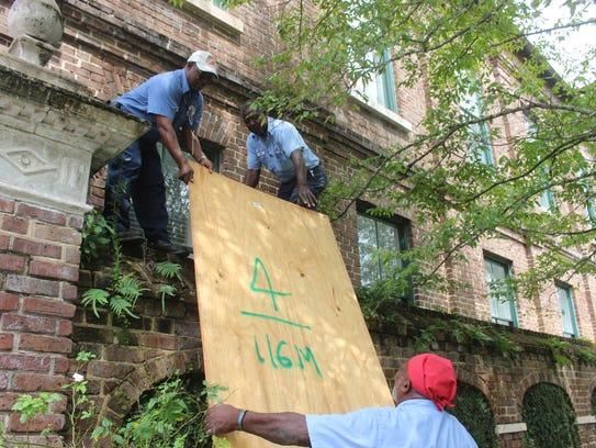 Charleston city workers Rusty Gadden, top left, Ray