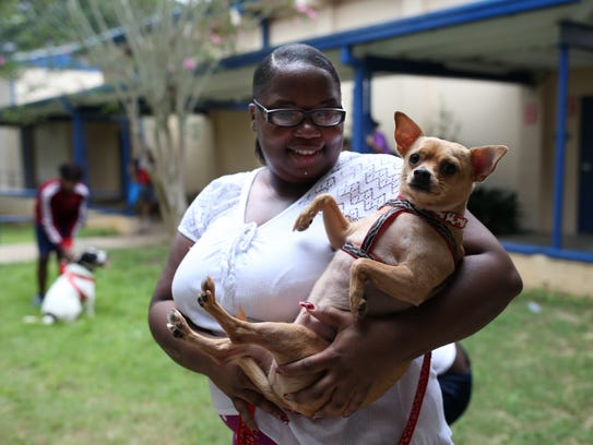 Monae Williams holds her dog Skippy at the Red Cross