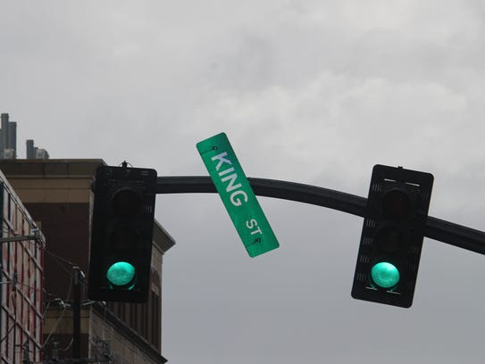 A street sign blows in the wind in downtown Charleston,
