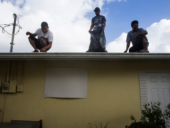 Maragarito Lucas, 37, from right, Francisco Juarez,