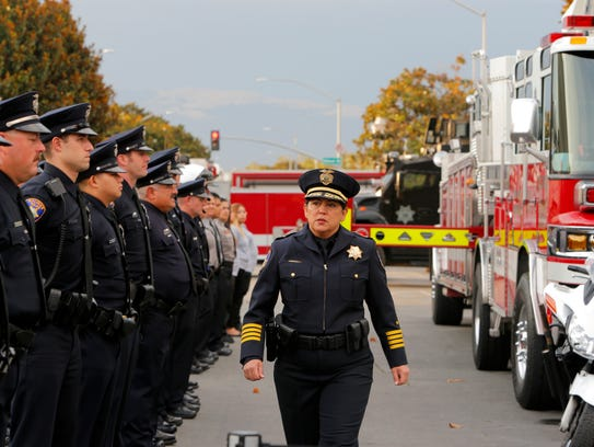 Salinas Police Chief Adele Frese walks in front of the officers during the Sept. 11 ceremony. A city-commissioned survey is seeking Salinas residents' opinions on the police and its relationship with the community.