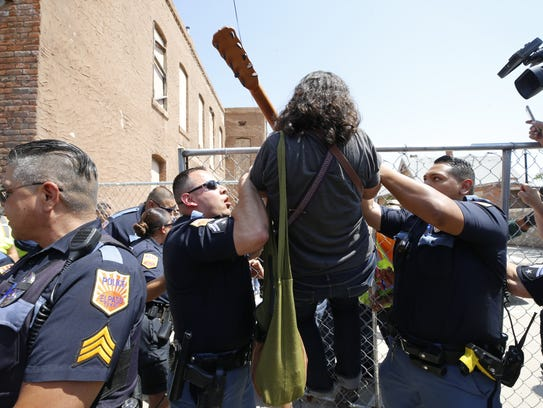 El Paso police deal with a protester Tuesday in Duranguito.