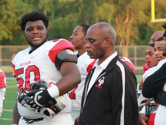 Oak Park offensive lineman Marquan McCall talks with